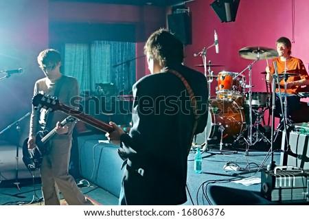 three music performers on scene - stock photo