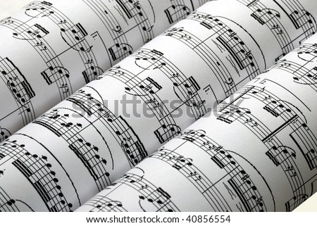 Three music sheets on a row isolated in white - stock photo