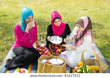 three muslimah girl breakfast at garden