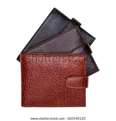 Three natural leather wallets isolated on white background. Expensive man's purses closeup - stock photo