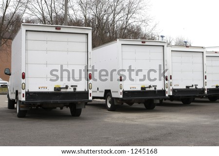 Three New Box Delivery or Moving Trucks