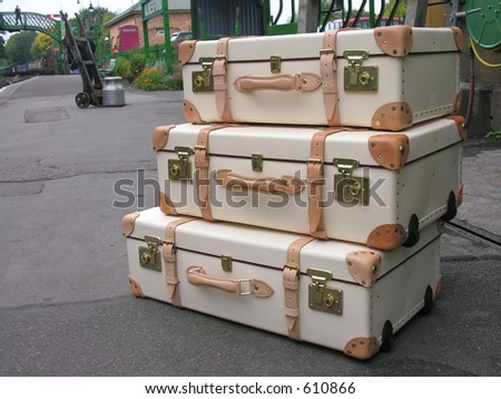 Three new suitcases - stock photo