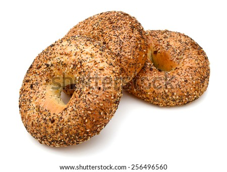 three nice sesame bagels on white background  - stock photo