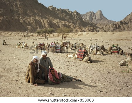 Three nomads in Egyptian desert - stock photo