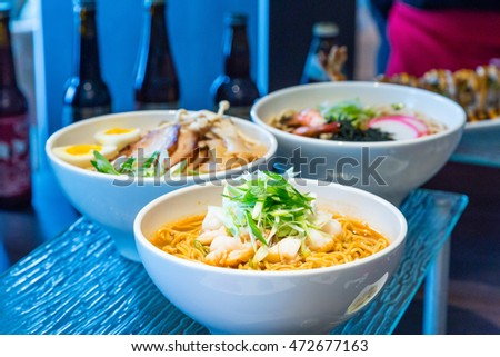 Three Noodle Dishes in Restaurant
