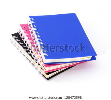 Three notebooks spiral bound on white background - stock photo