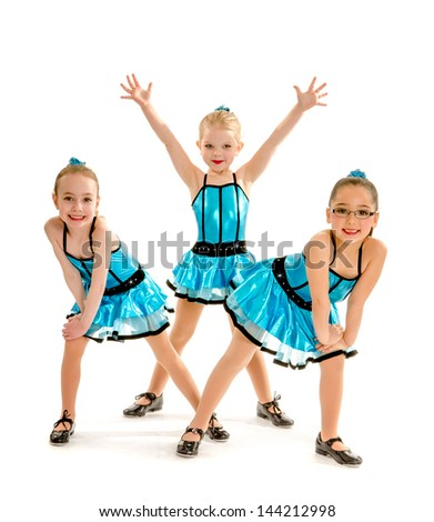 Three Novice Girl Students Pose in Blue Recital Tap Costumes