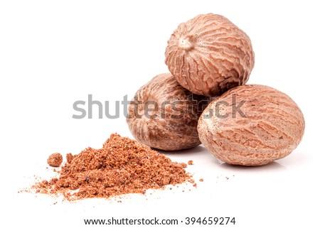 Three nutmeg whole and powder isolated on white background - stock photo