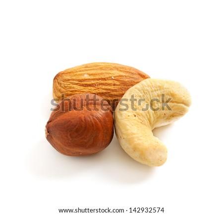 Three  nuts (almond, hazelnut, cashew,) isolated on white, macro - stock photo