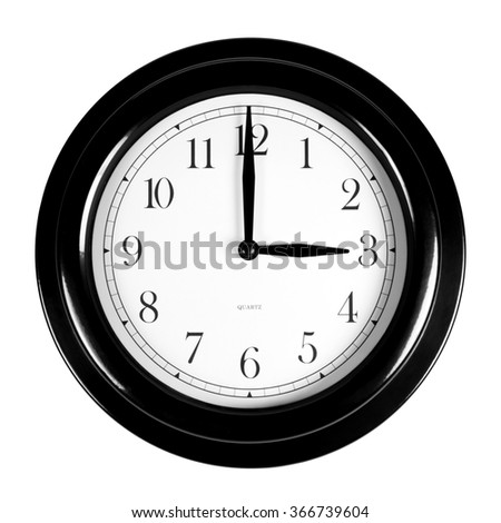 Three o'clock on the black wall clock, isolated on white background - stock photo