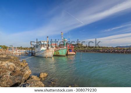 Three of fisherman boats parking at Big Buddha pier - stock photo