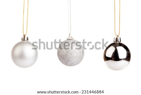 Three of silver color christmas tree baubles isolated on white background - stock photo