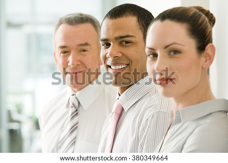 Three office workers in a row