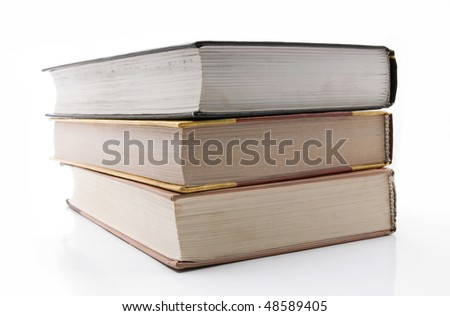 Three old books lie in the pile