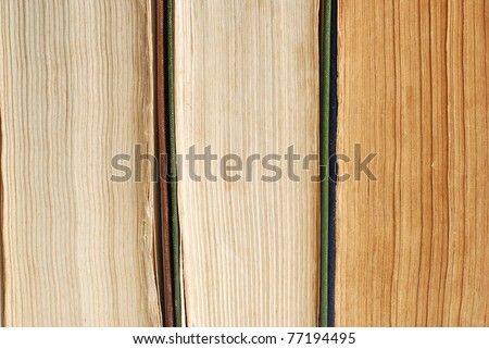 three old books with yellowed pages next to each other - stock photo