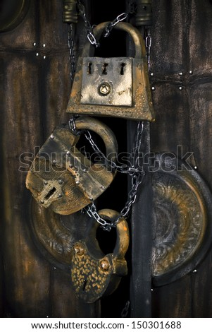 three old huge padlocks on the doors