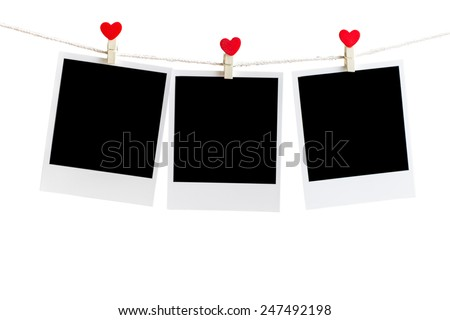 Three Old picture frame hanging on the clothesline over white,Clipping path for insert Photo - stock photo