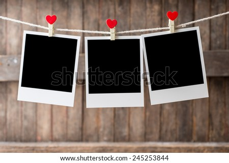 Three Old picture frame hanging on the clothesline.,Selective focus,Clipping path for insert Photo - stock photo