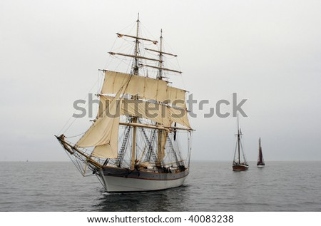 Three old ships sailing in the baltic sea - stock photo