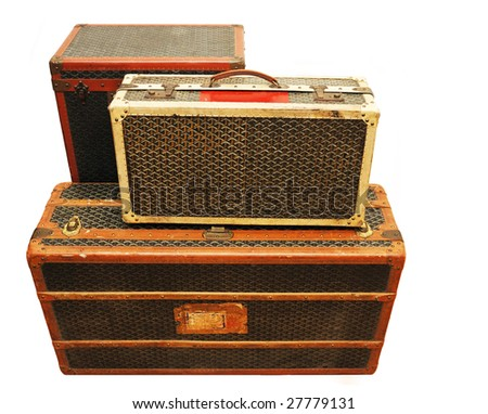 Three old suitcases isolated over white background.