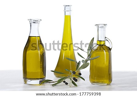 three olive oil bottle, and a branch of black olive on white background  - stock photo
