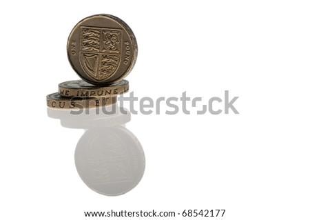 three one pound coins isolated on white - stock photo
