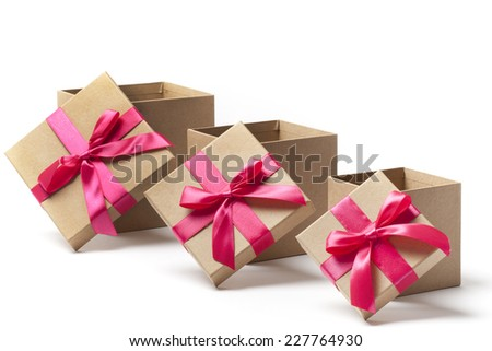 Three open carton gift boxes different sizes with red ribbons isolated on white  - stock photo