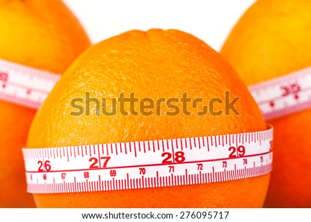 Three oranges with tailor's ruler. Orange diet. Fruit healhy vitamin diet helps to lose weight.