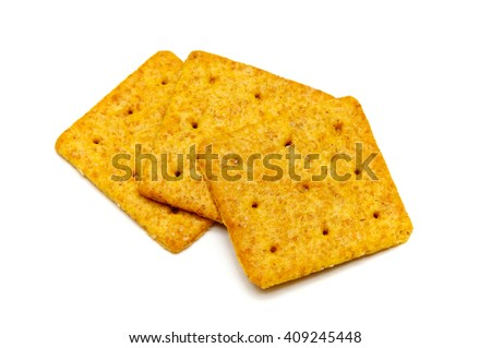 Three organic thin square wheat baked crackers or biscuits over white. Not Isolated.