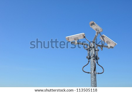 Three outdoor security cameras with housing on the pole cover multiple angles.clipping path included - stock photo