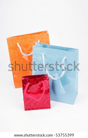 Three packages for gifts on a white background