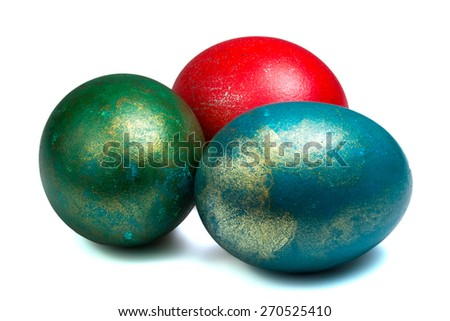 three painted easter eggs with metallic glitter isolated