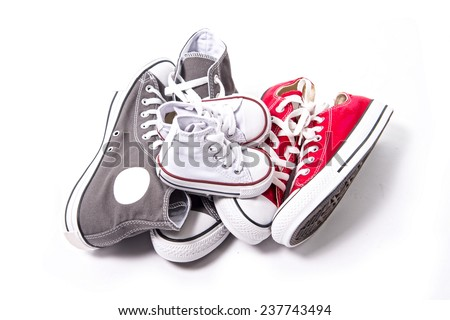 three pair of shoes in father big, mother medium and son or daughter small kid size representing family, growth, education and togetherness concept  - stock photo
