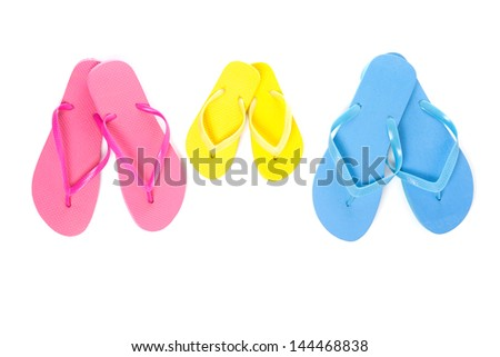three pairs of flip flops on white background