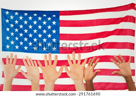 Three pairs of hands waving against rippled us flag