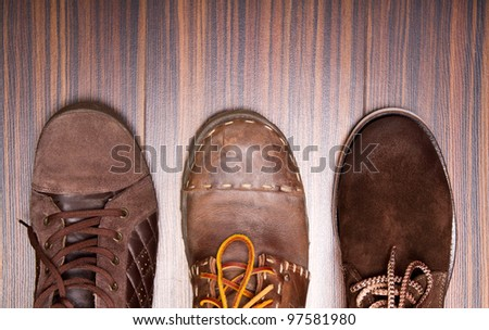 Three pairs of shoes from above - stock photo