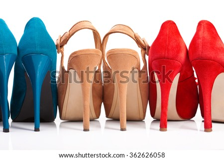 Three pairs of women's shoes with heels on a white background - stock photo