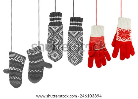 Three pairs of woolen knitted mittens on a white background - stock photo