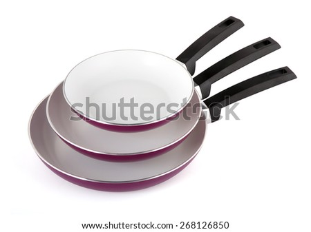Three pans isolated on white background - stock photo