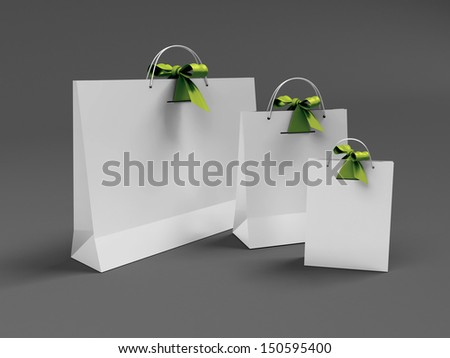 three paper bags for gifts and purchases tied ribbons - stock photo