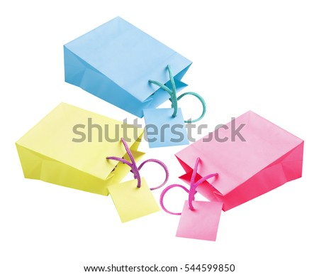 Three Paper Bags With Tags Lying on White Background