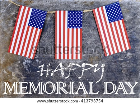 Three paper cutout American flags hanging from twine in front of scratched and stained steel background gives a rustic vibe with a Memorial Day message - stock photo