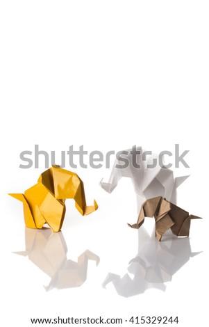 Three paper origami elephants family isolated on white background - stock photo