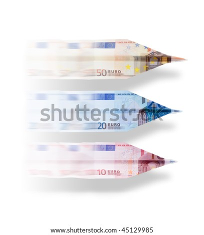 Three paper planes made of euro notes  (50, 20 and 10) flying. - stock photo