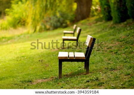 three park benches on the morning - stock photo