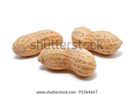 Three Peanuts Isolated on White - stock photo