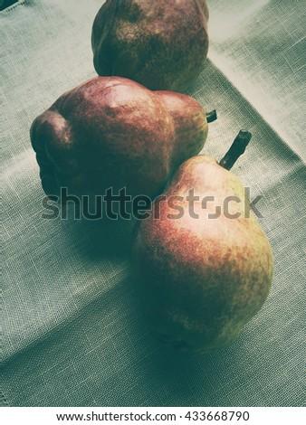 Three pears on a napkin - stock photo