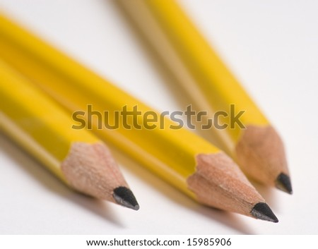 Three Pencils Close Up on White