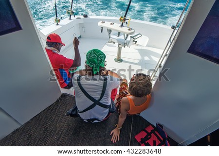 Three people are fishing