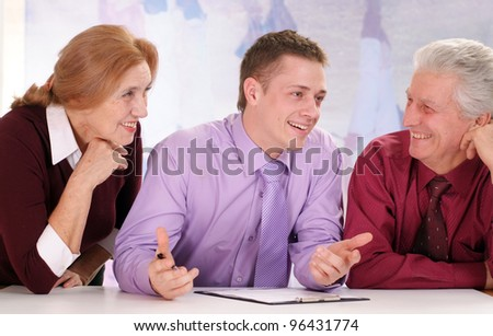 Three people are sitting on a isolate - stock photo